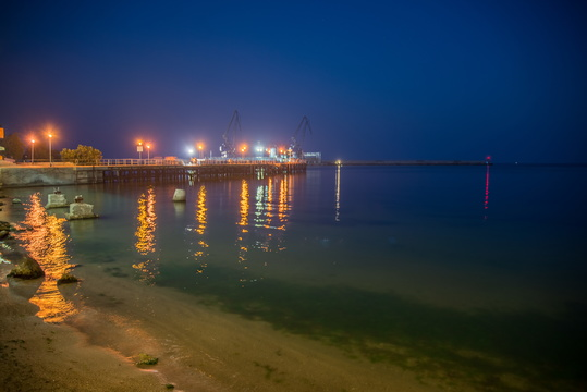 Sea cranes at night
