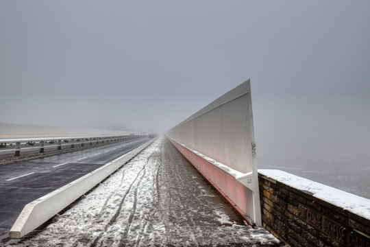 Red Bridge with snow and fog