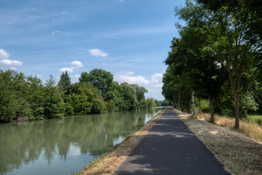 Freshly paved cycling route along the canal
