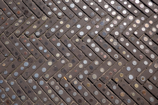Coins on paving stones