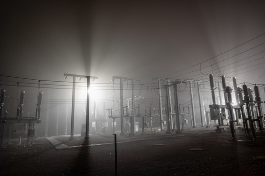 Power substation in the night fog