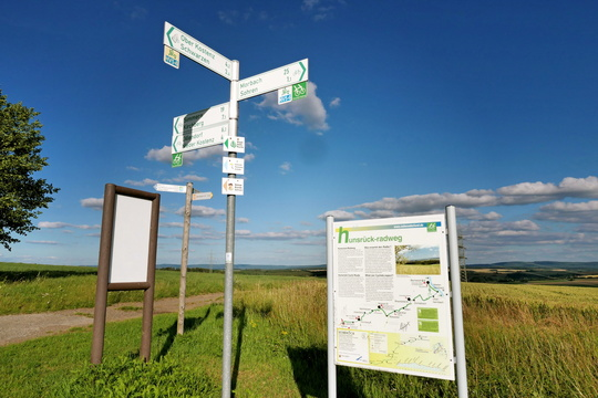 Cycling directions signs and information board near Sohren